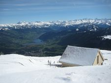 Snow Coered House Overlooking Valley. Royalty Free Stock Photography