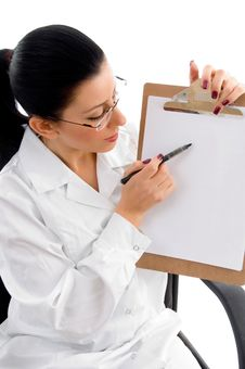 Free Female Doctor Indicating Writing Pad Stock Photo - 8277150