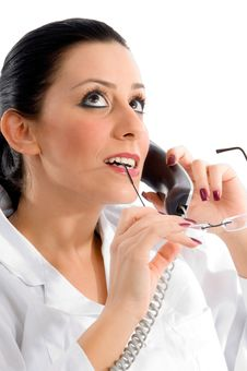 Free Doctor Talking On Phone And Looking Upward Stock Images - 8277204