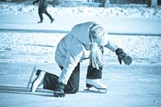 Free Girl On Skates Fell On The Ice. Royalty Free Stock Images - 8279579