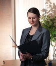 Free Young Attractive Business Woman With Folder Stock Photo - 8282120
