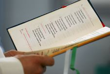 Priest Reading Open Holly Bible, Wedding In Poland Stock Image