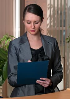Free Young Attractive Business Woman With Folder Royalty Free Stock Image - 8282176