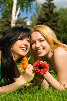 Women Rest In The Park With Flowers Stock Image