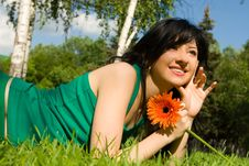 Woman Rest In The Park With Flower Stock Image