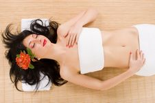 Free Spa Brunette With Flowers Royalty Free Stock Images - 8283439