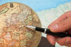 A Hand And The Globe Stock Image