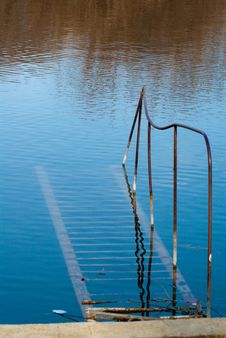 Free Rusty Staircase Going Nowhere In The Water Stock Images - 8287034