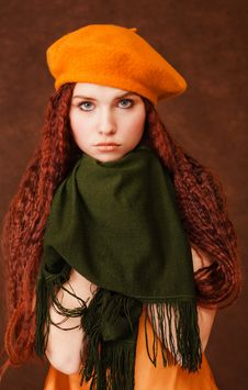 Free Young Girl In Orange Beret On Dark Background Royalty Free Stock Images - 8287199