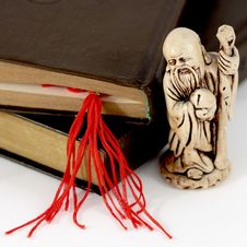 Netsuke, Books And Red Bookmark Stock Photography