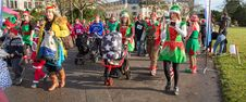 Free Elves In Christmas Parade Royalty Free Stock Images - 82892539