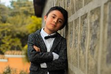 Free Elegant Boy Leaning Against Wall Royalty Free Stock Images - 82898609