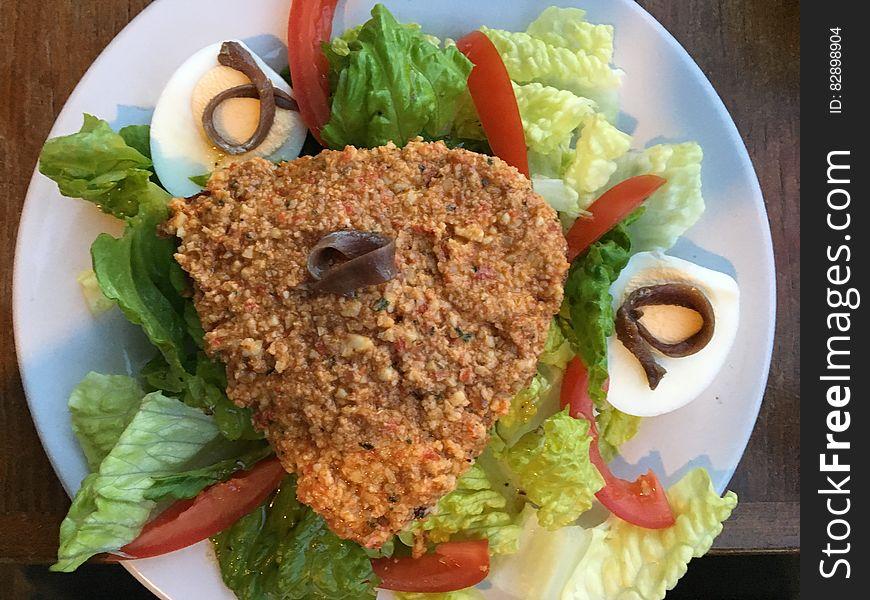 Fried meats on salad