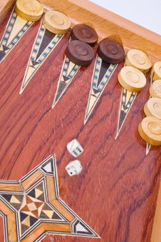 White Dices Falling On Wooden Backgammon Board Stock Image