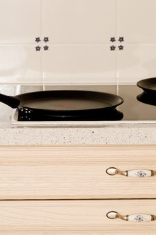 A Frying Pan On A Stove Royalty Free Stock Photos