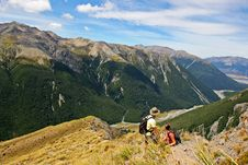 Couple Climbing Avalanche Peak Stock Image