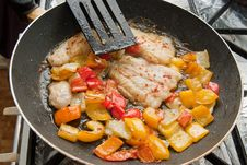 Cooking Fish And Peppers Stock Images