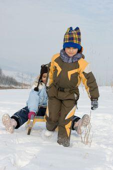 Running Boy With Sleihg Royalty Free Stock Photos