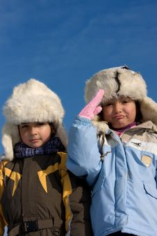 Free Cute Girl And Boy In The Fur-cap Stock Images - 8297474