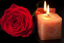 Red Rose And Candles Over Black Stock Photography