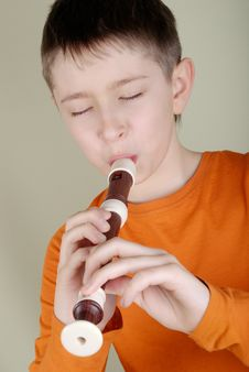 Free Boy Playing The Flute Royalty Free Stock Images - 8298439