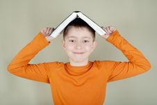 Free Boy With A Book On Her Head Stock Image - 8298461