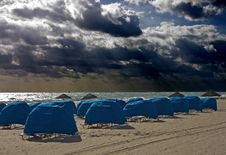 Free Blue Umbrellas Under Stormy Skies Stock Images - 8299414