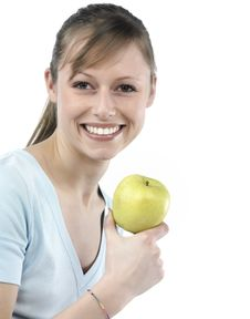 Free Woman Holding A Green Apple Stock Image - 8299471
