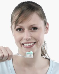 Free Woman Brushing Her Teeth Royalty Free Stock Image - 8299496