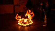 Free Children Lighting Candles In Circle Royalty Free Stock Image - 82913276