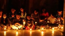 Free Children In Candlelight Stock Photography - 82913442