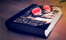 Free Black Framed Sunglasses On Black Book Stock Photo - 82930260