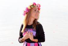 Free Woman In Black Purple And Pink Long Sleeve Dress And Pink Yellow And Beige Rose Headdress Stock Images - 82930864