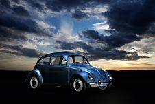 Free Blue Volkswagen Beetle Under Blue Sky And White Clouds During Golden Hour Stock Images - 82931344