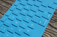 Free Blue Computer Keyboard On Gray Wooden Surface Royalty Free Stock Images - 82931739