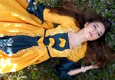 Free Woman In Yellow And Blue Dress Lying On A Grass Field Stock Photo - 82932490