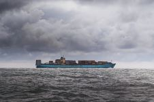 Free Cargo Ship In Grey Waters Stock Photos - 82932593