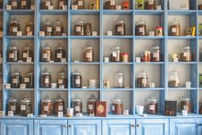 Free Assorted Jars On Blue Shelf Cabinets Stock Photo - 82932690