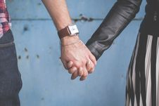 Free 2 Person Holding Hands Besides Blue Painted Wall Stock Photos - 82932833