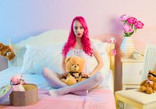 Free Pink Long Haired Woman Sitting On Double Bed With Bear Plsuh Toy At Daylight Royalty Free Stock Image - 82932856