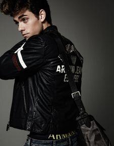Free Man In Black White Leather Jacket Wearing Grey Crossbody Bag Stock Photography - 82933792