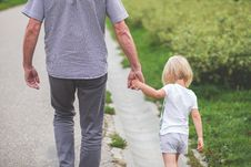 Free Man And Child Walking Near Bushes During Daytime Stock Photos - 82933883