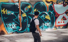 Free Man In Front Of Wall With Graffiti Royalty Free Stock Photo - 82934185