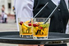 Free 2 Whisky Glasses Filled With Beverage On Black Tray Stock Images - 82934374