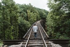 Free Man Walking On Train Railway In The Middle Of The Woods Stock Images - 82935304
