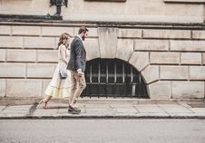 Free Man In Black Formal Suit Jacket Walking Together With Woman In White Sleeveless Dress Stock Images - 82935944
