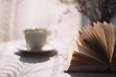 Free Tilt Lens Photography Of Open Book With Ceramic Cup In Saucer Royalty Free Stock Photography - 82936147