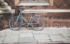 Free Blue Bicycle Parked On Brown Bricked Wall Royalty Free Stock Photography - 82936407