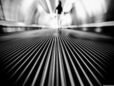 Free Greyscale Photography Of Man Walking On Tunnel Stock Photo - 82936760