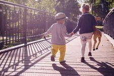 Free Boy And Girl Walking On Bridge During Daytime Royalty Free Stock Images - 82936779